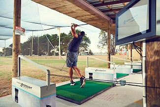 Play some of the world's best courses on our driving range